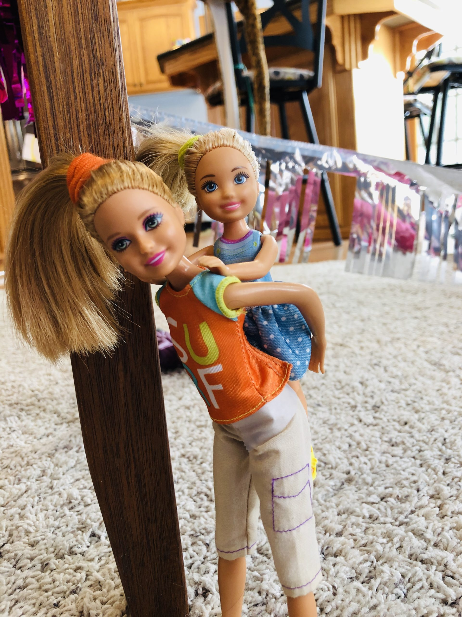 A Stacie Doll (Charlotte) is giving a piggy back ride to Brynn, a Chelsea Doll for a Barbie Doll Story