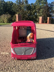 Barbie driving a pink camper from the Barbie Doll Story, Trekking to School.