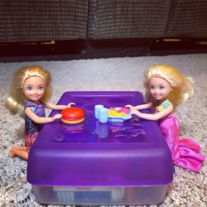 2 Chelsea dolls having a snack for the Barbie Story.