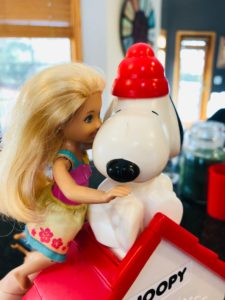 Brynn kissing the Snoopy Snow Cone Machine for the Barbie Story.