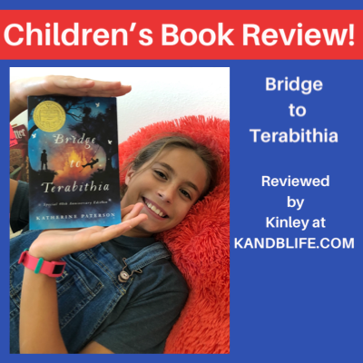 Children's Book Review title in White with Blue background, with a picture of a girl holding the book Bridge to Terabithia.