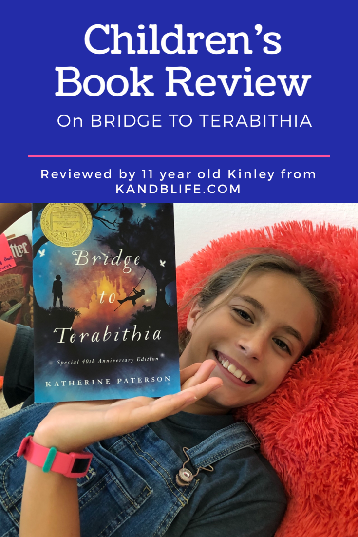 For the children's book review, 11 year old girl holding the book Bridge to Terabithia.