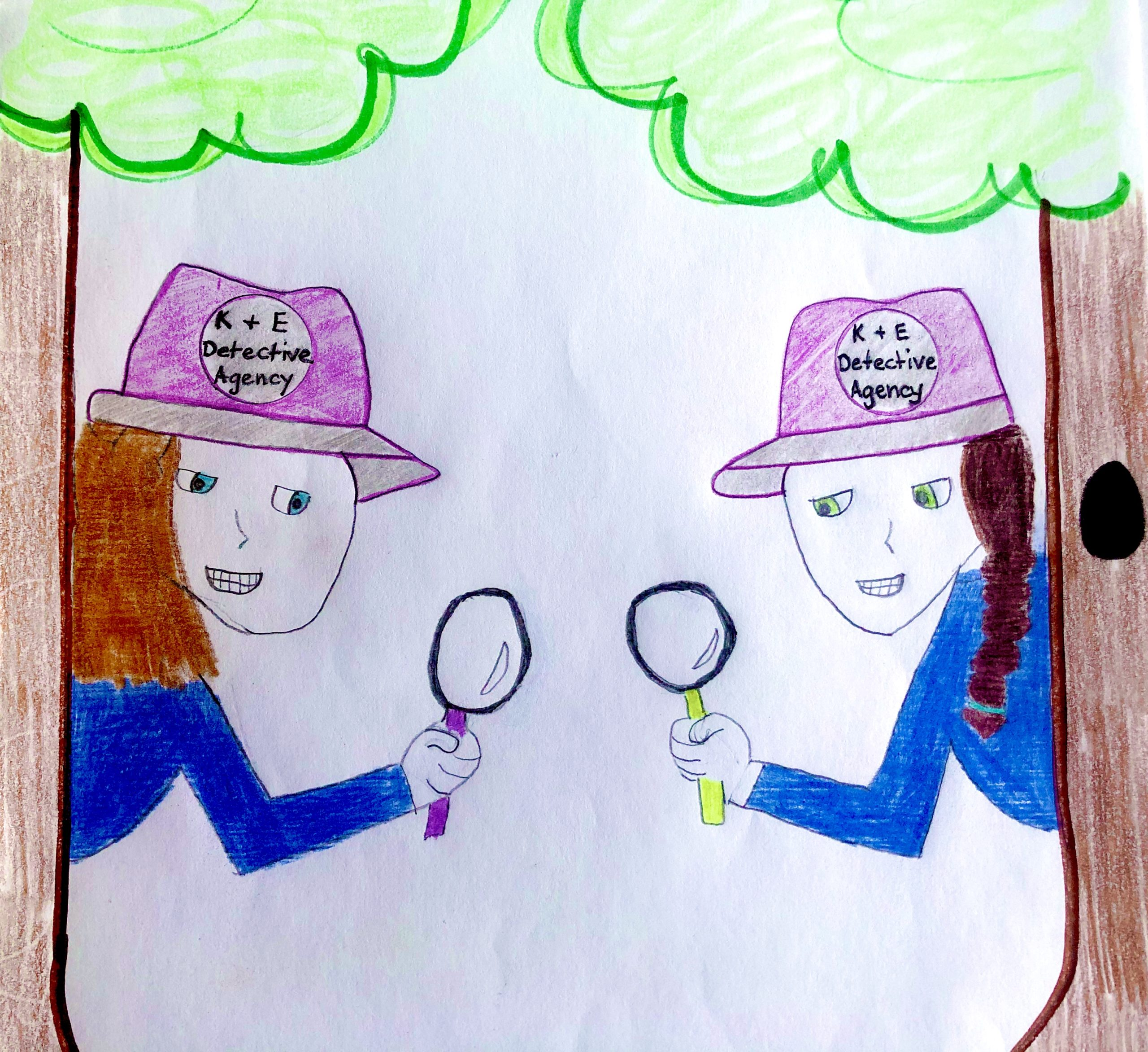 The Detectives Kinley and Ella hiding behind 2 trees with magnifying glasses in their hands. They're wearing matching blue, long sleeved shirts and purple detective hats with the logo K & E Detective Agency on it.