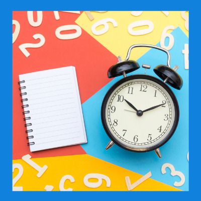 A clock with a notepad.