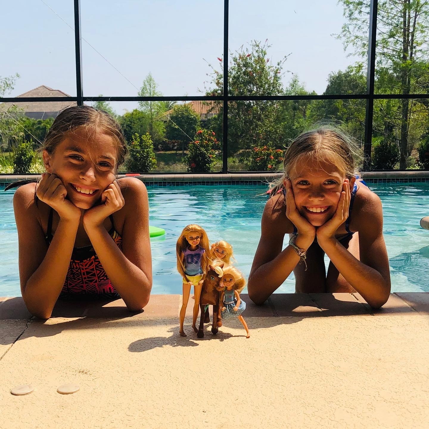 Picture of Kinley and Brecken with 3 Barbies for the Contact Us Page at KandBlife.com