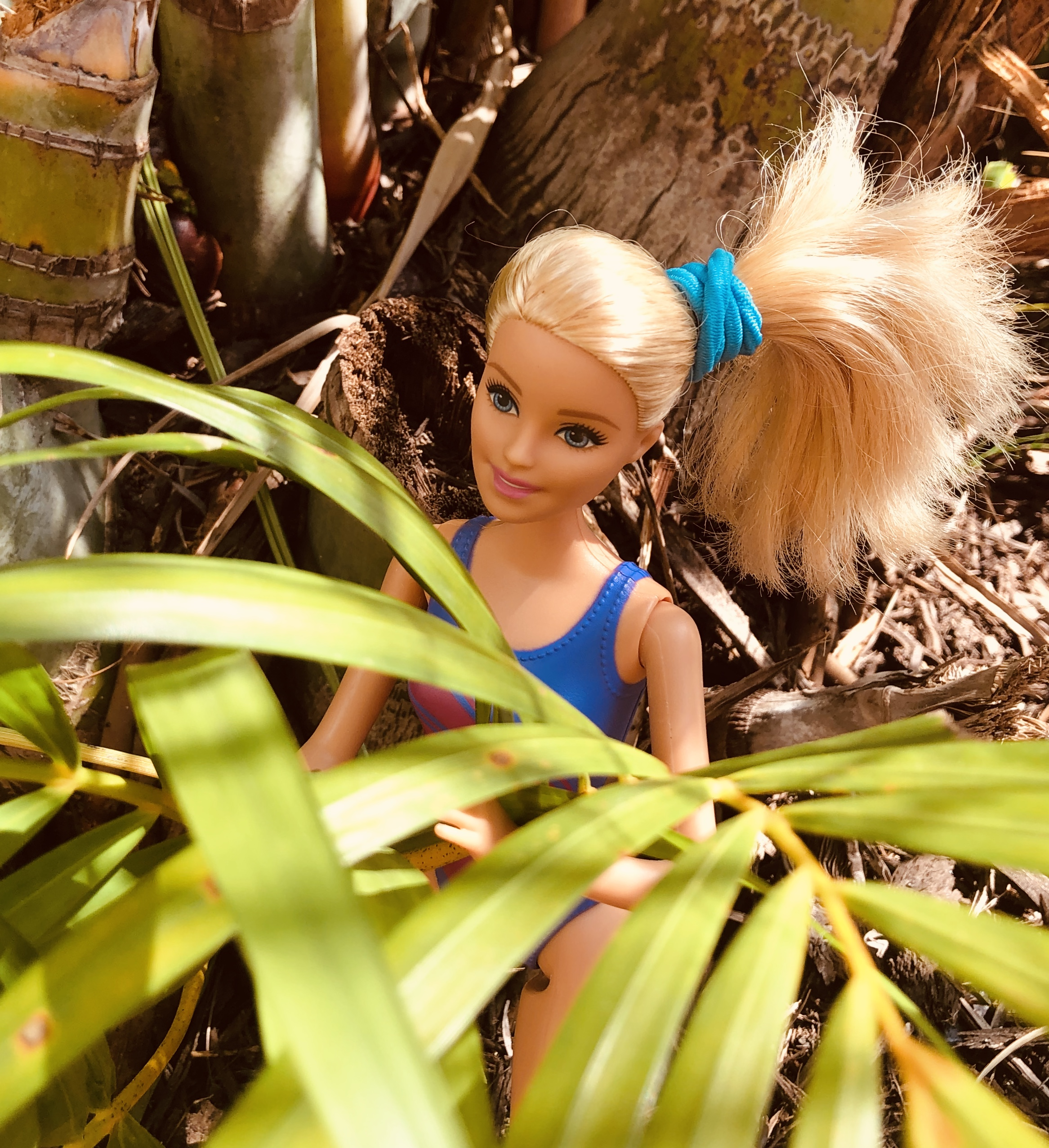 Barbie Doll with a ponytail in some leaves for the Barbie Story for kids, Hiking in Costa Rica.