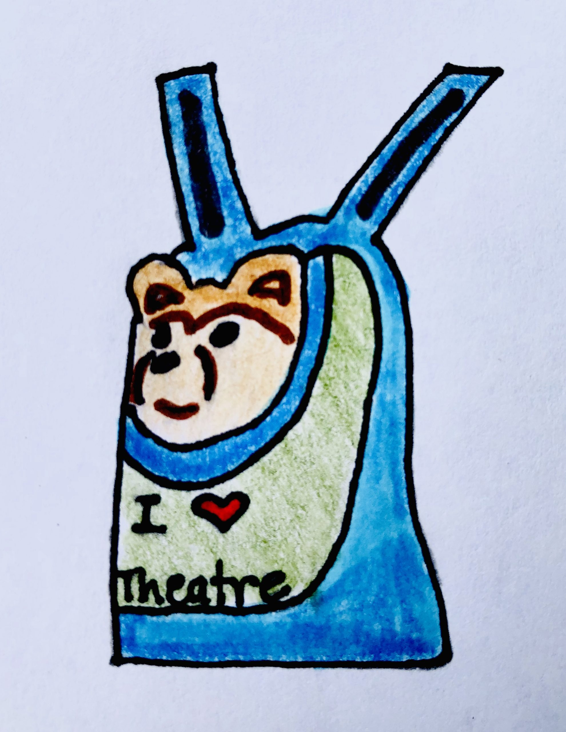 """In a blue and green backpack is a Pomeranian stuffed animal dog. His head is sticking out and the backpack has """"I love Theatre"""" on the front. It's from the mystery story for kids, The Case of the Stolen Stuffy."""