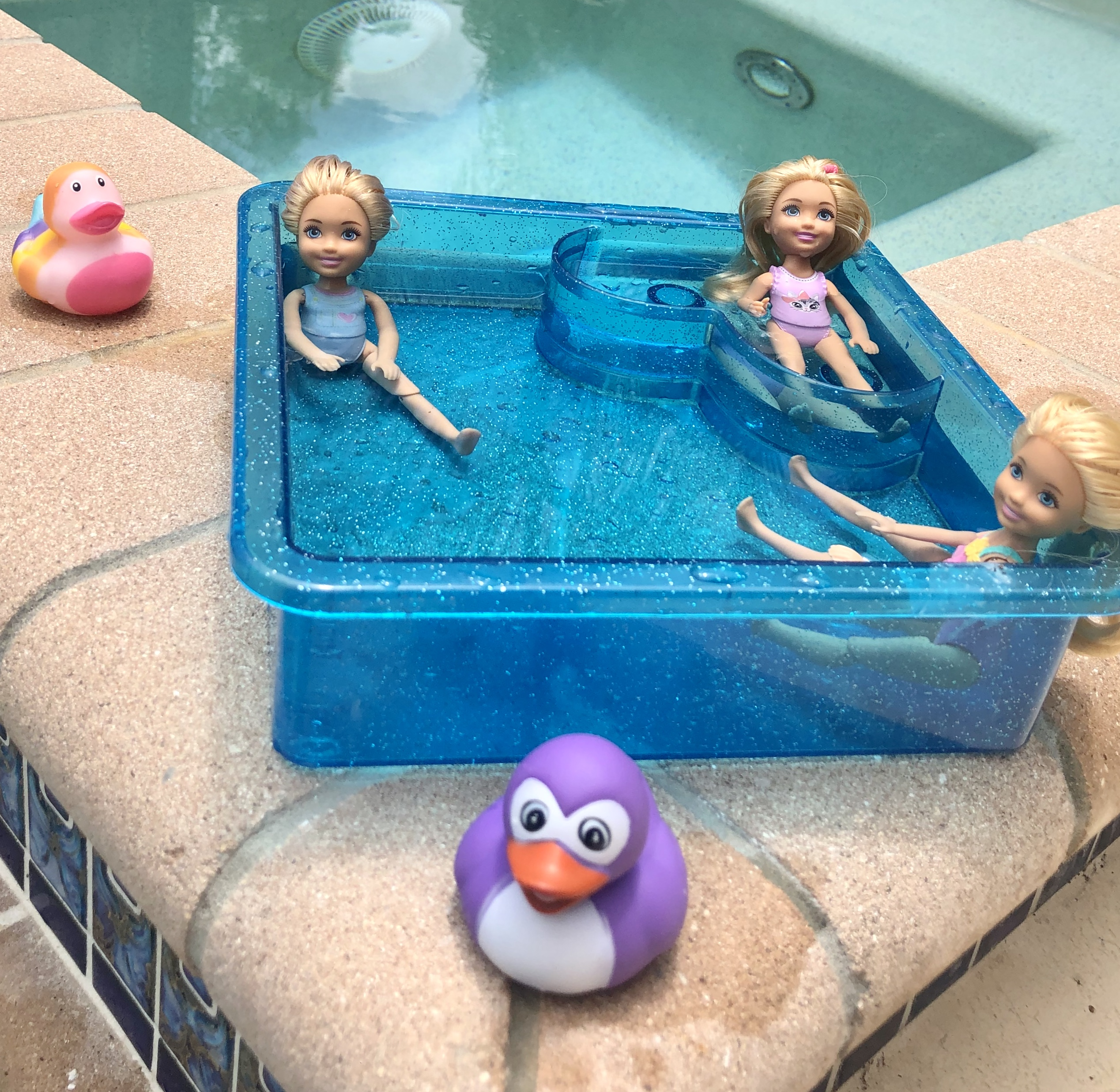 3 Chelsea dolls in a little pool for the Barbie Doll Story, Goodbye Costa Rica.