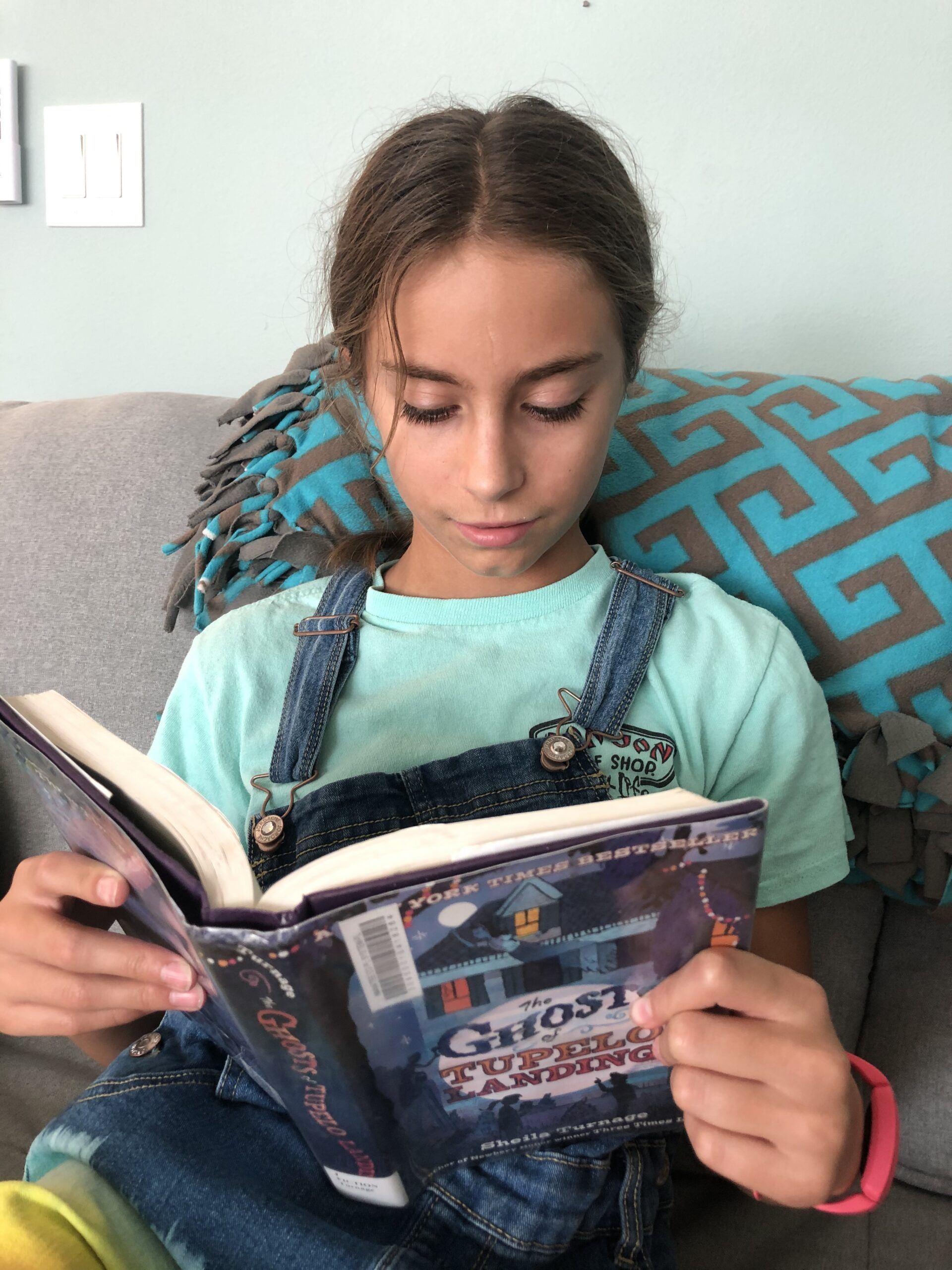 11 year old girl, Kinley, reading The Ghosts of Tupelo Landing for the children's book review.