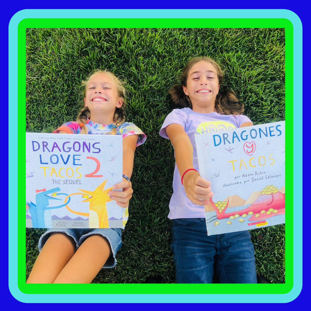 2 girls holding 2 books for the children's book Review on Dragons Loves Tacos. and The Sequel.