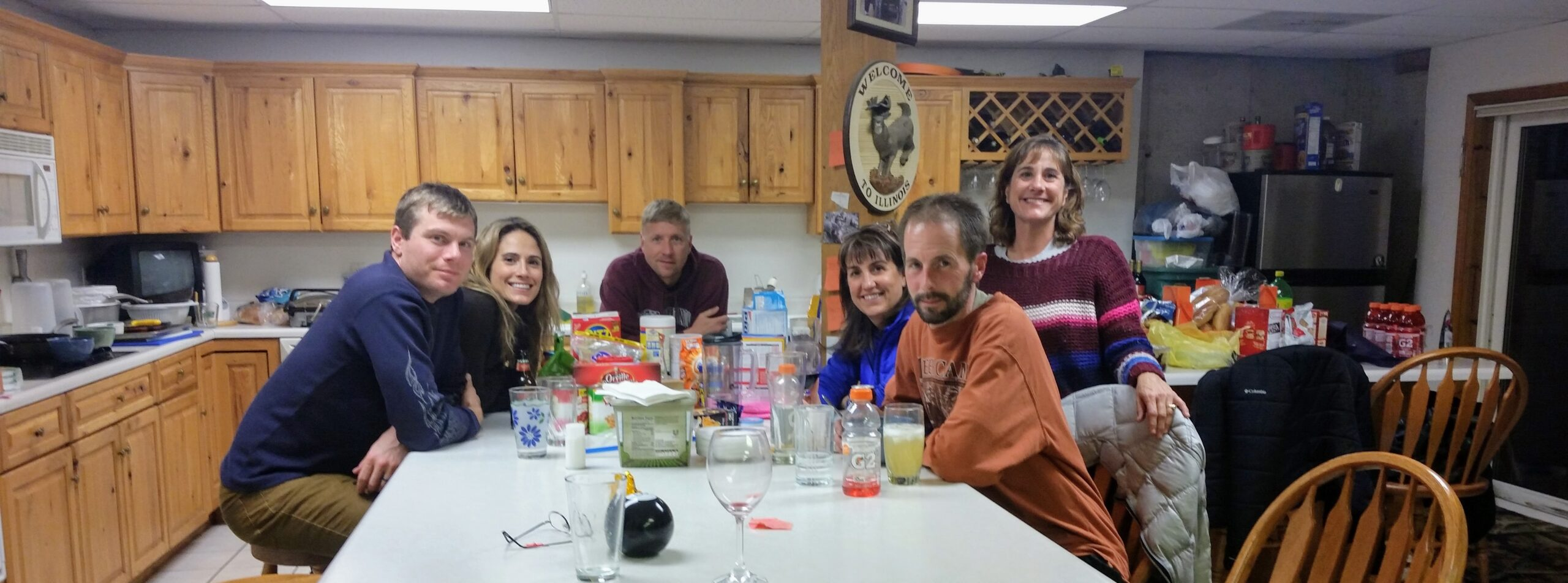 A bunch of people sitting around a kitchen for the holiday story, The Best Thanksgiving Ever!