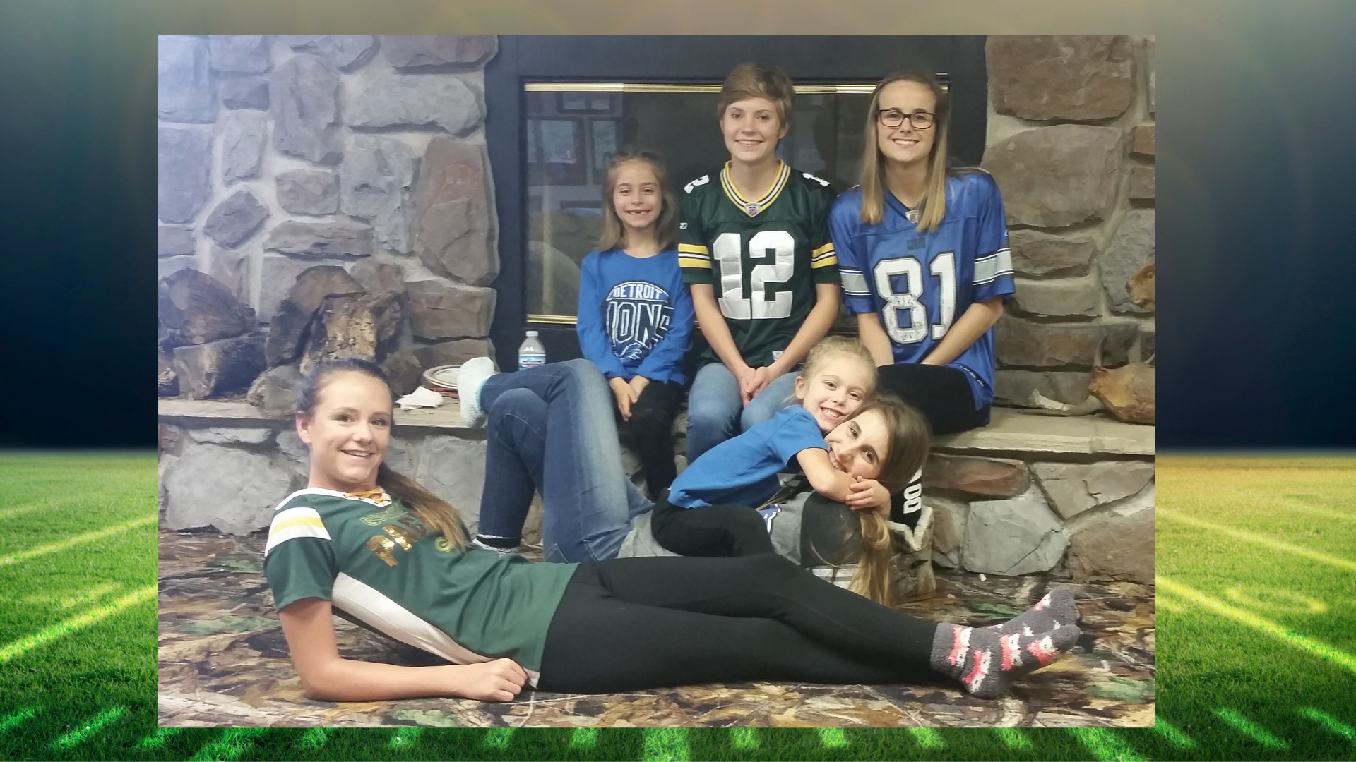 Girls in Detroit Lions and Green Bay Packers jerseys.