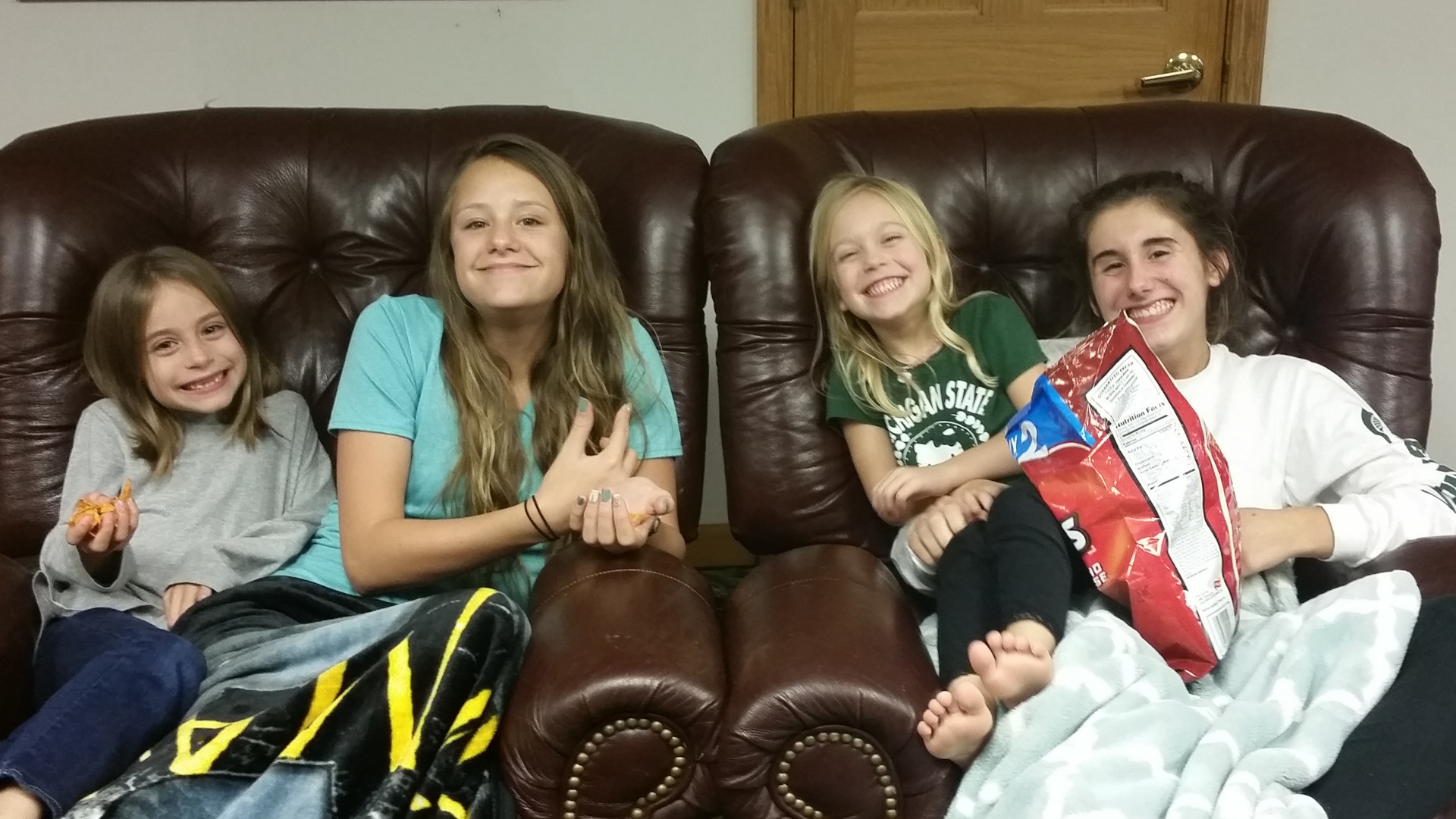 A group of girls snuggling up for the Holiday Story, The Best Thanksgiving Ever!