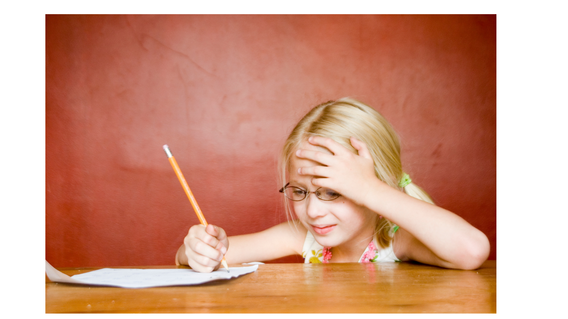 Unhappy girl writing for the article 3 Reasons Kids Hate Writing.