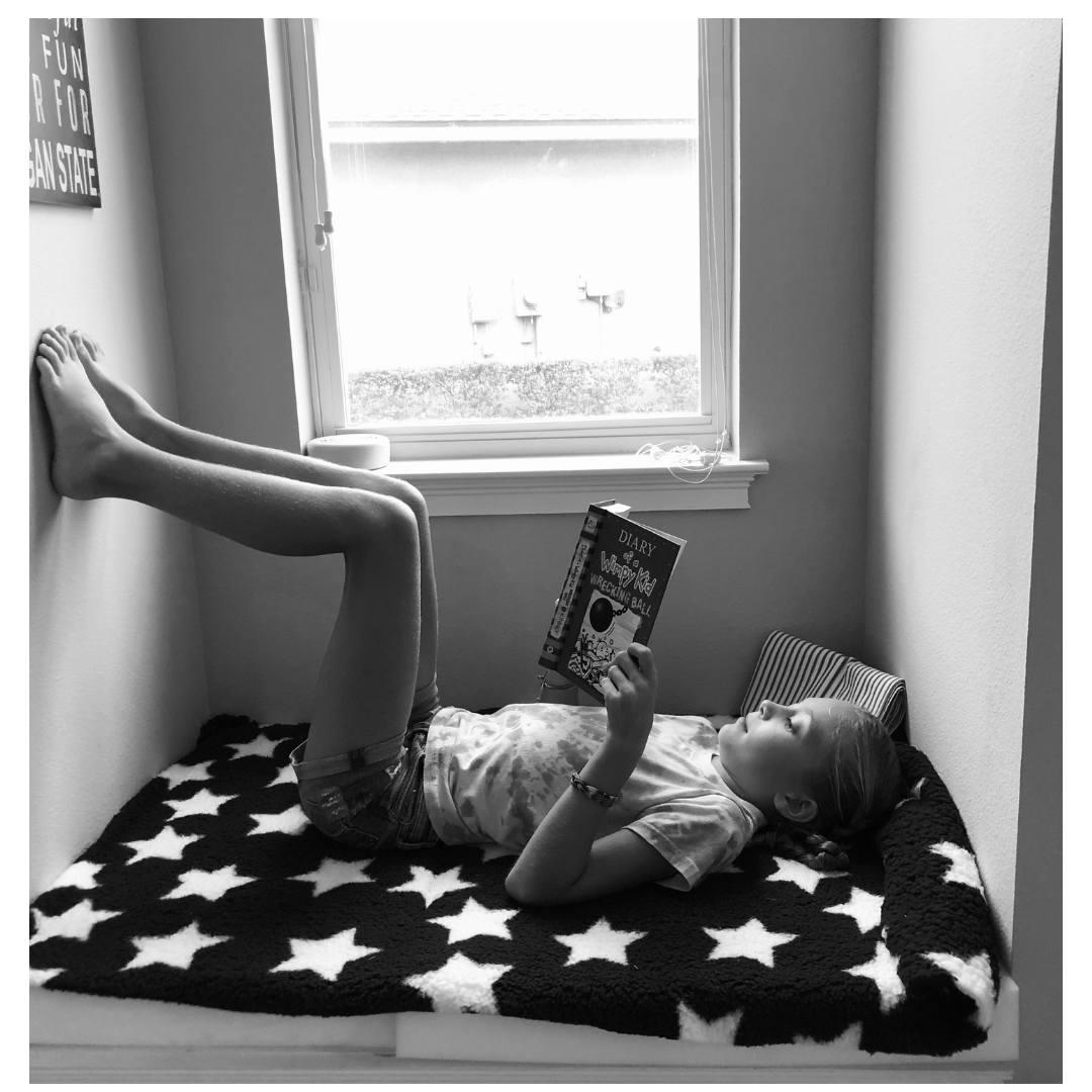 Black and White picture of a child reading