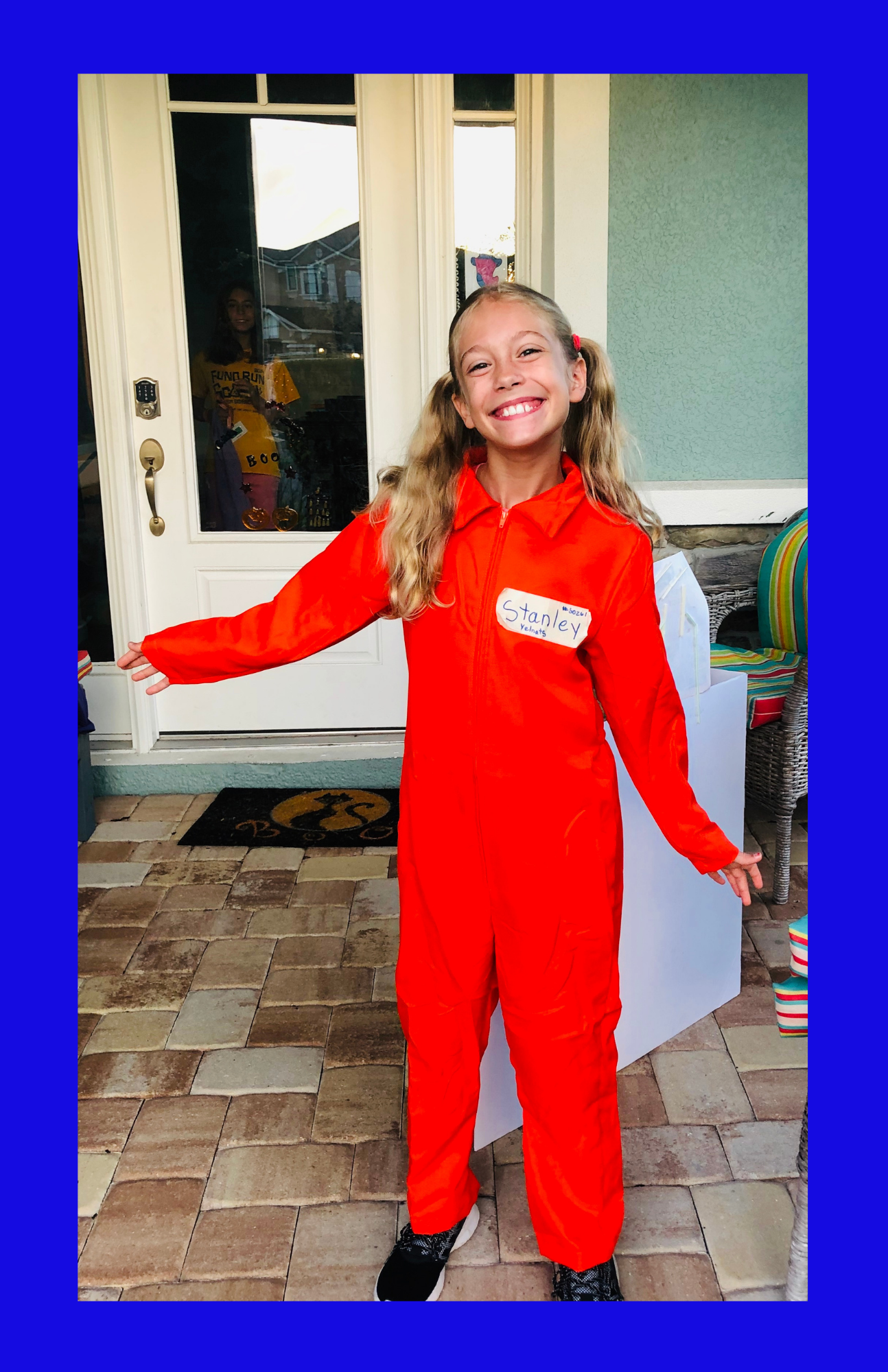 A blonde girl dressed as Stanley Yelnats for the book Holes. Children's Books Gift Guide 2020.