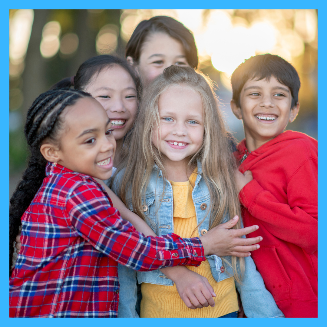 Group of kids hugging/smiling