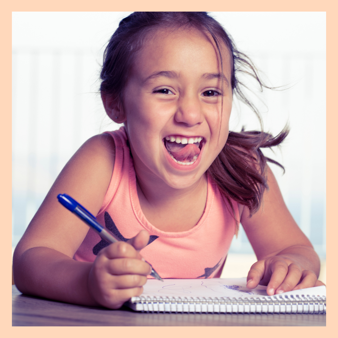 A girl being happy writing in a Gratitude Journal called My 5 Little Things