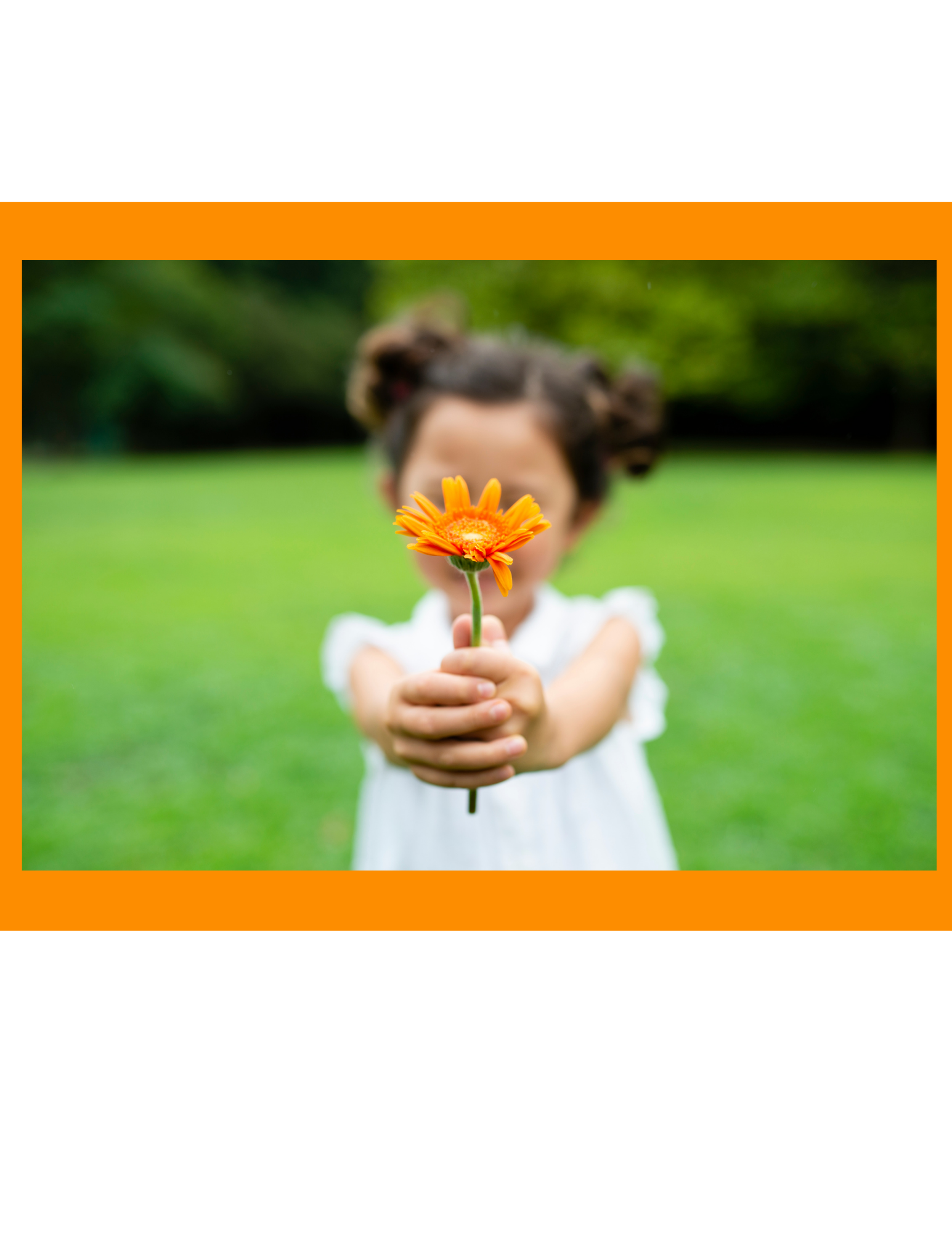 A little girl giving an orange flower.
