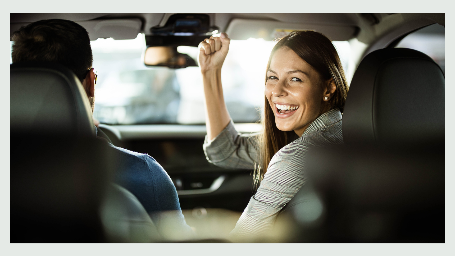 A woman happy in the car.