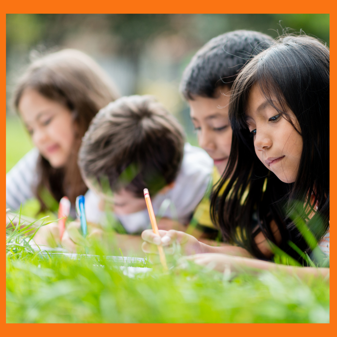 Kids outside writing as an example for the article, Summer Writing Ideas for Kids.