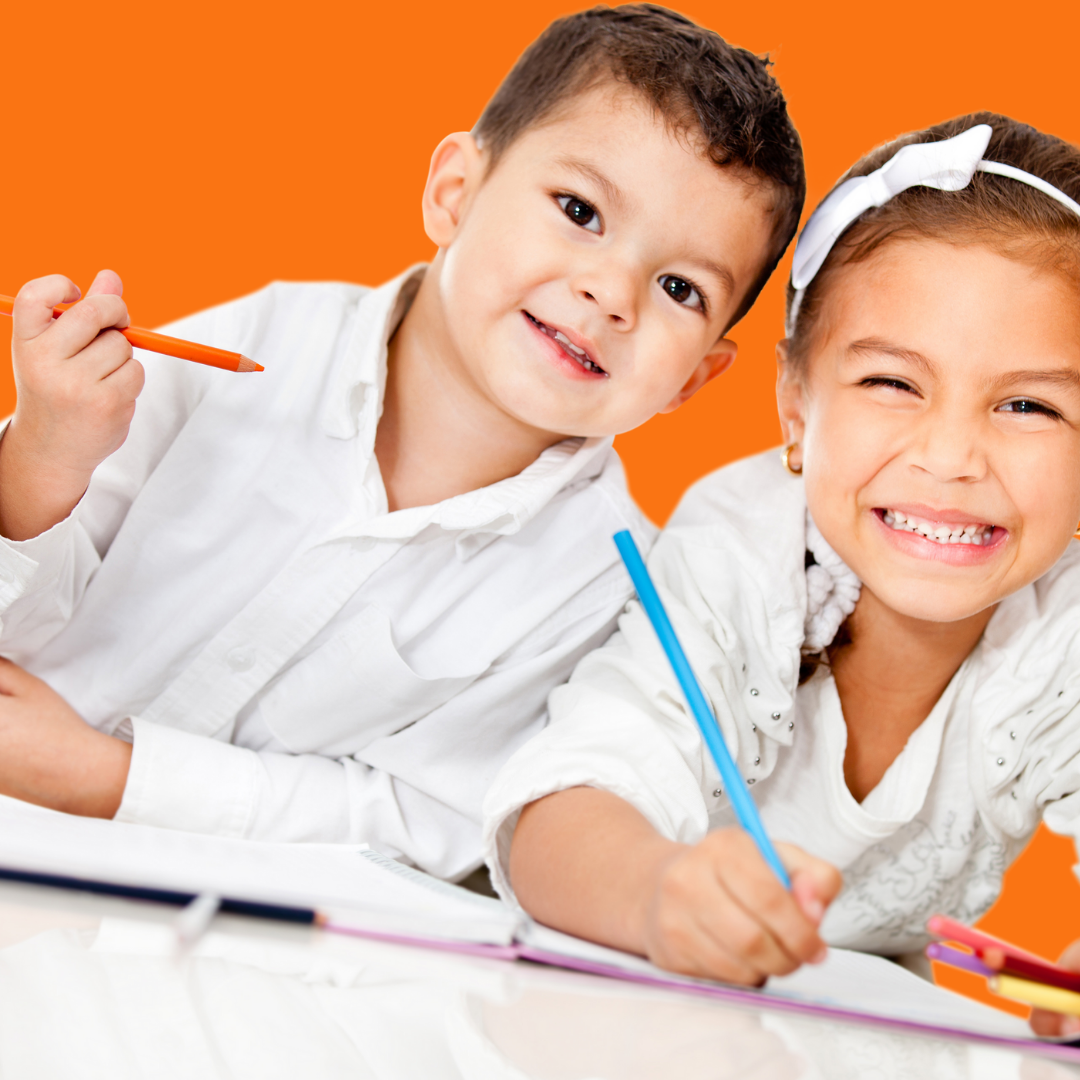 2 kids smiling at the camera taking a break from writing for the article, Summer Writing Ideas for Kids.